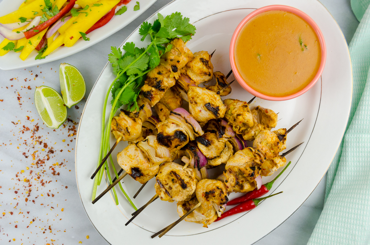 Chicken grilled to perfection in a spicy, coconuty Thai curry marinade