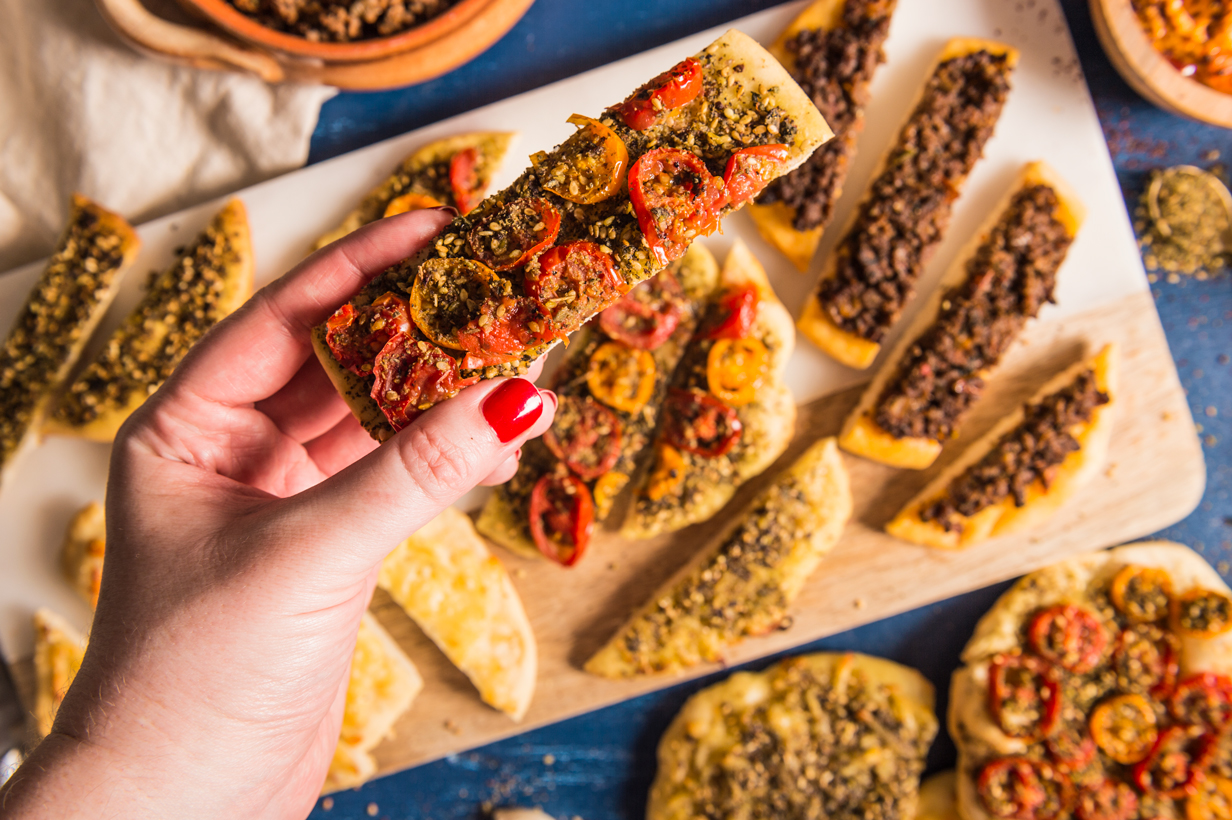 Middle Eastern pizzas with zaatar, halloumi cheese, spiced meat and tomatoes