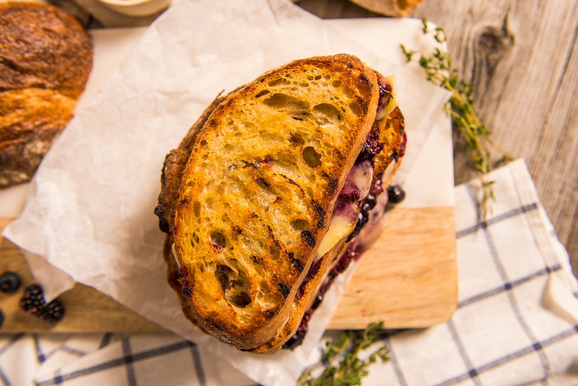 Gruyere cheese, fresh blueberries and blackberries, thyme and Merlot on a sourdough loaf