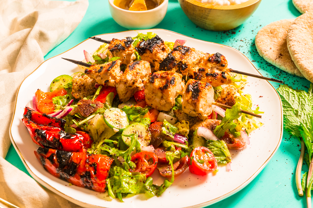 Middle Eastern fattoush salad with a lemon juice dressing and chicken marinated in a spiced yogurt base and grilled