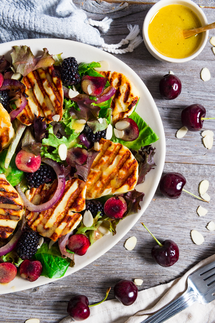 Mixed greens topped with grilled halloumi cheese, cherries, blackberries, pickled onions, almonds and a mustard vinaigrette