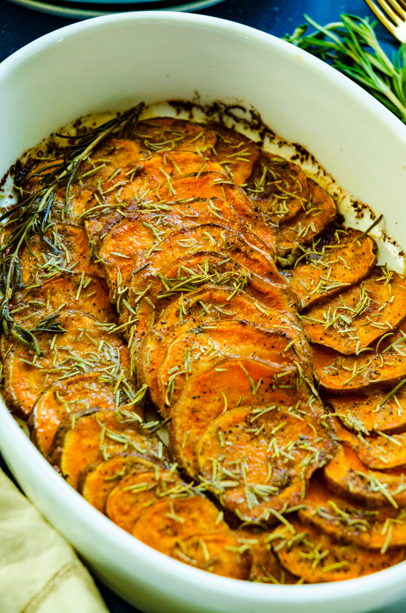 Slices of sweet potatoes roasted in truffle oil, rosemary and pepper. The easiest, crowd pleasing side ever!