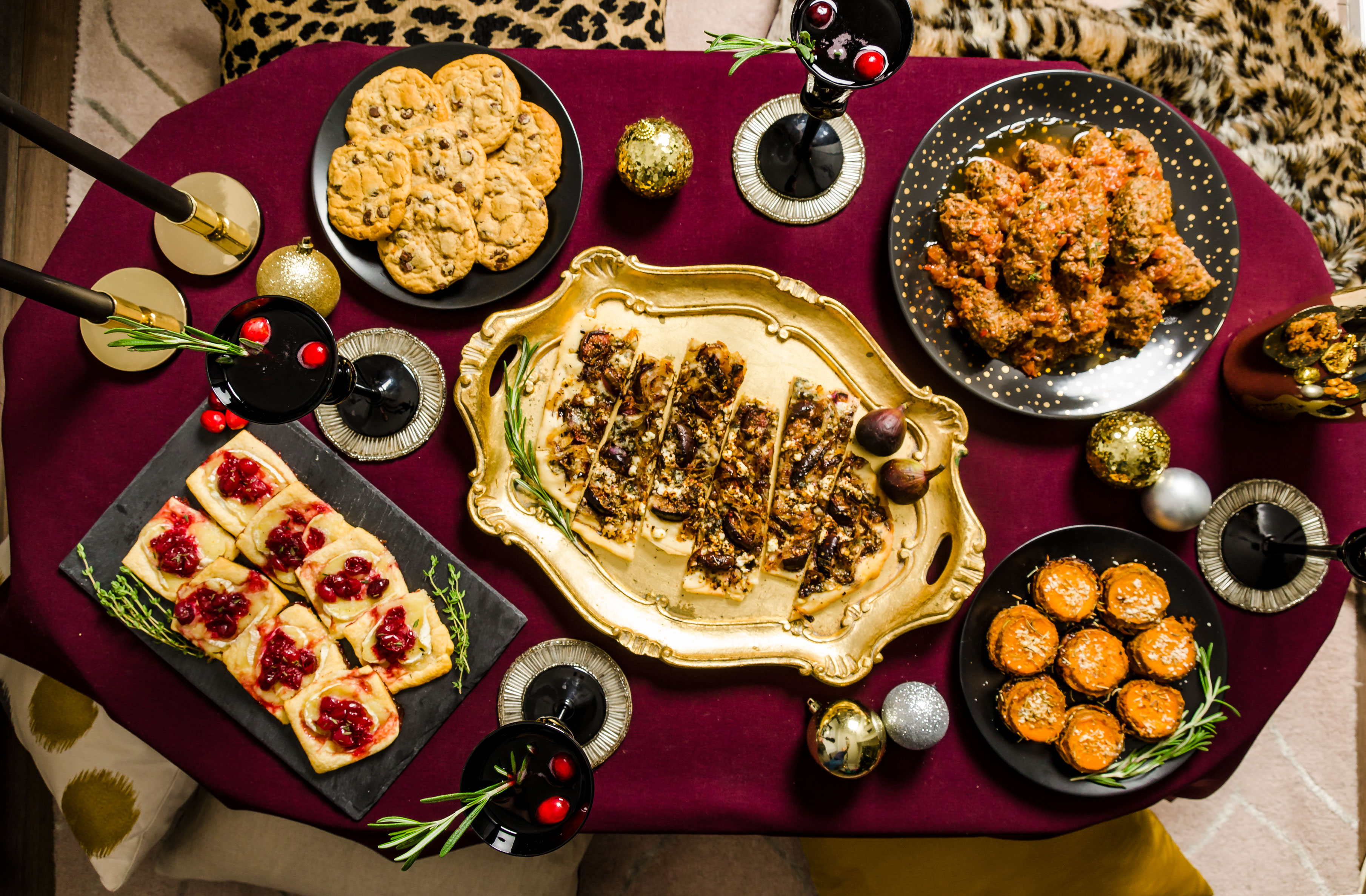 A holiday table designed for entertaining in smaller homes by sitting around the coffee table. Includes a holiday menu with bite sized edibles to save space and host guests with ease.