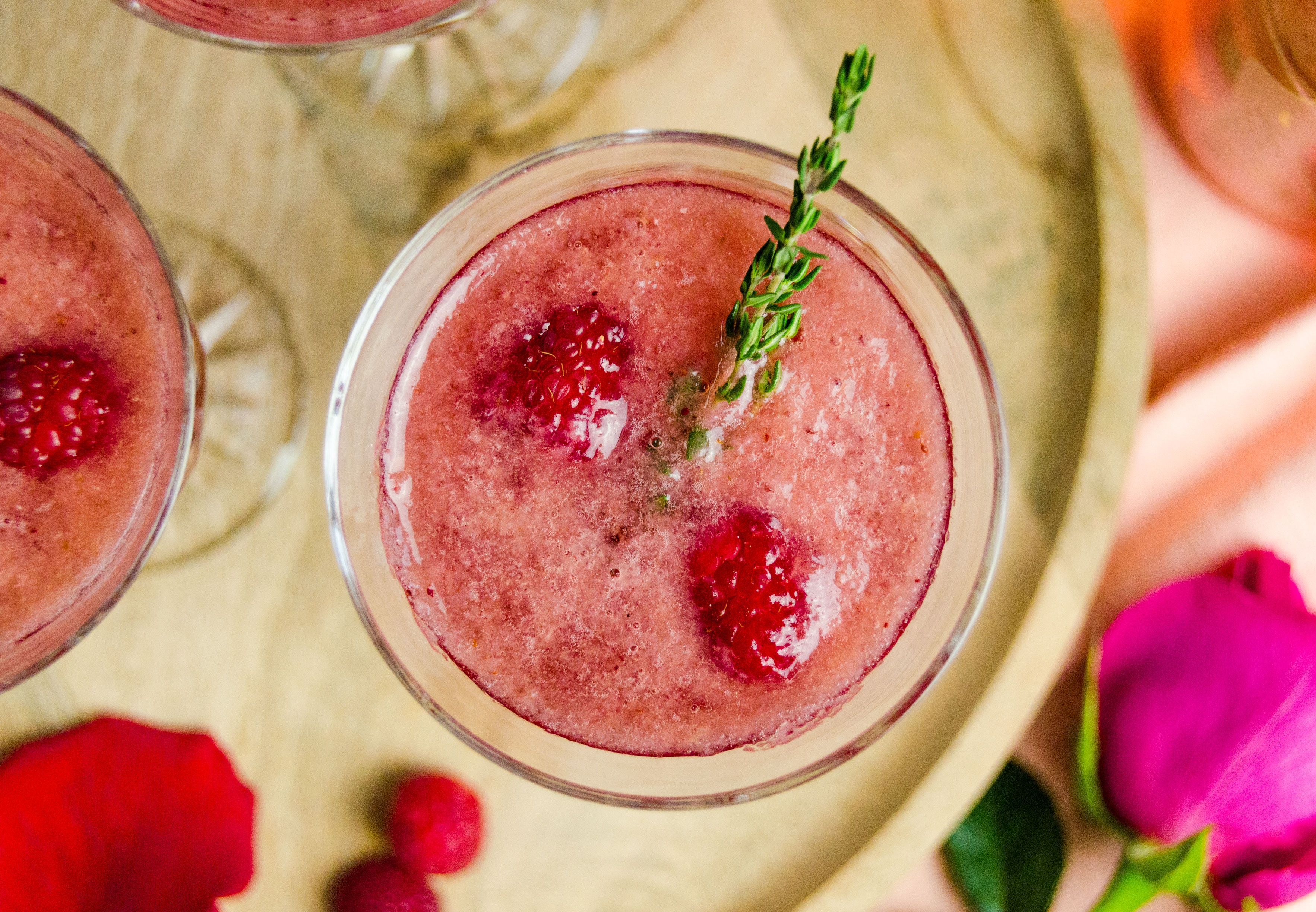 A bubbly, fresh raspberry cocktail with rose water and plenty of rosé to top it off. Perfect for Valentine's Day!